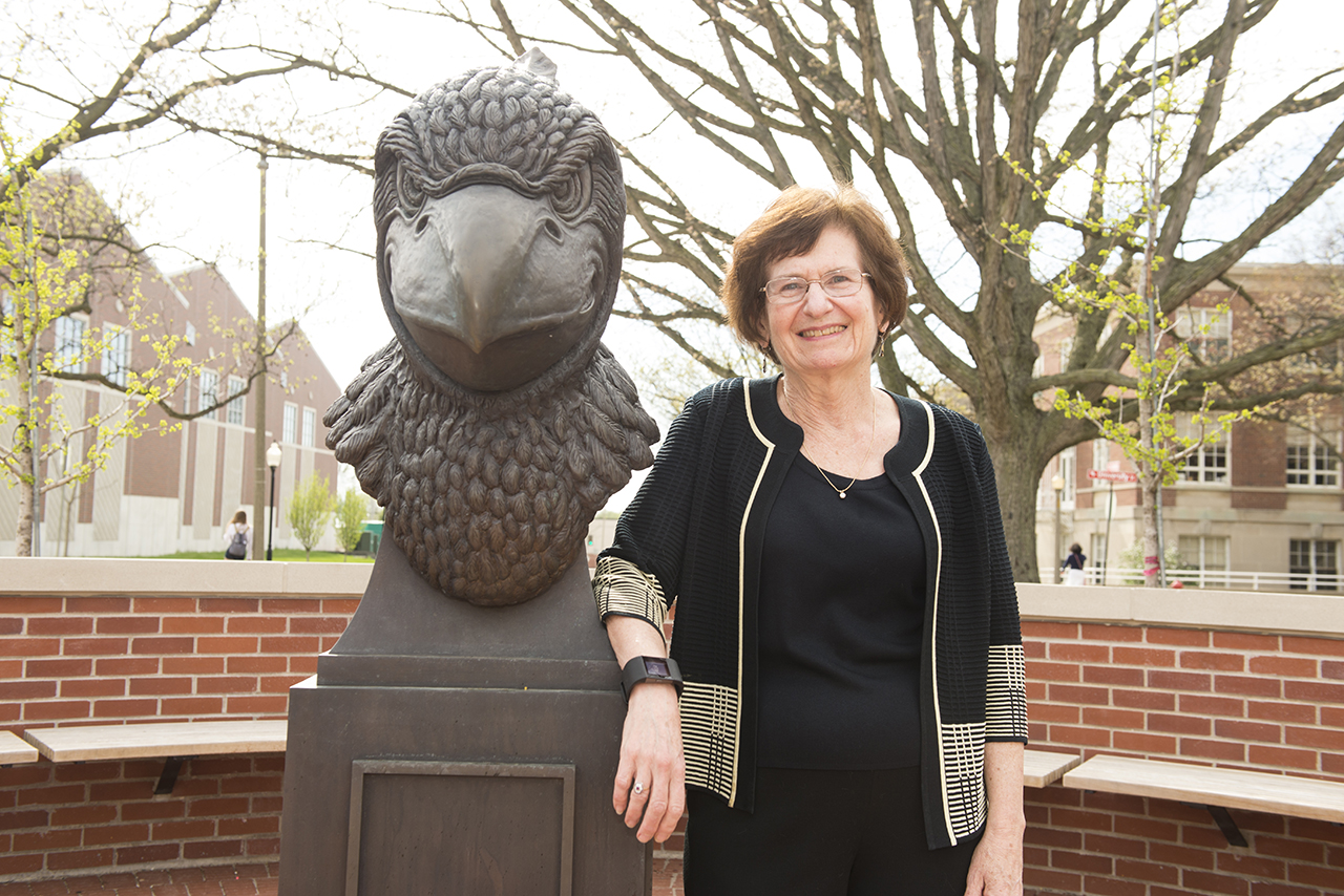 Illinois State was the perfect academic home for Distinguished Professor of Psychology Laura Berk. next to Redbird head statue