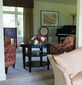 Student artwork and the home's piano