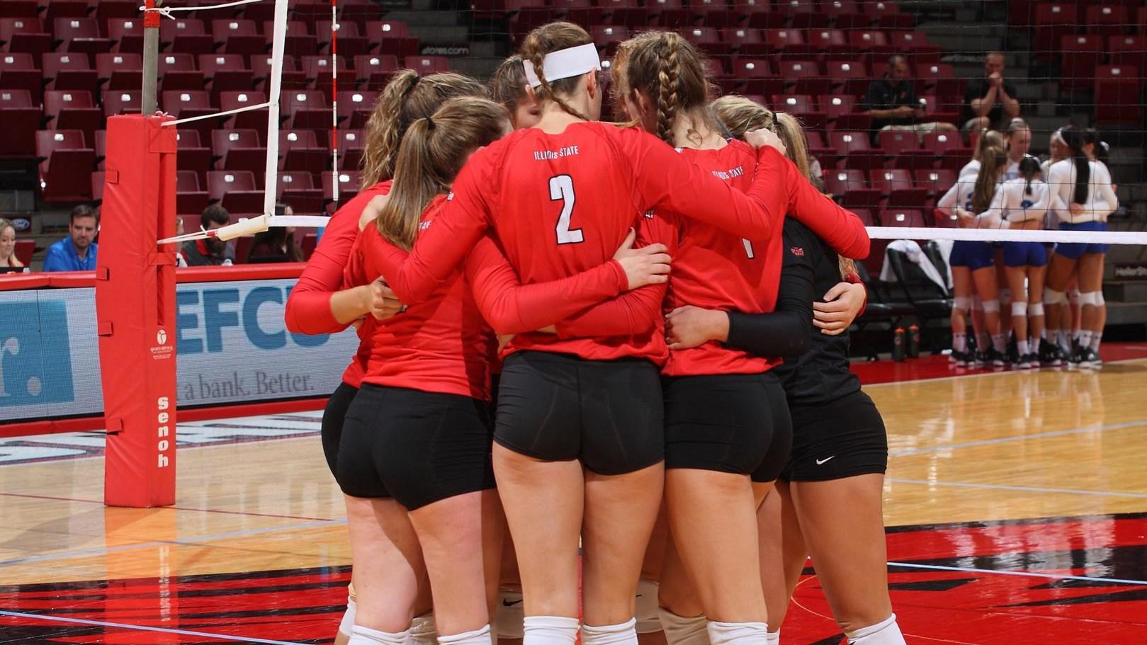 women's volleyball players huddled up ISU
