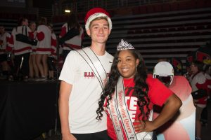 boy in crown and woman in tiara smiling