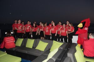 Madrigals singing group performing on top of the Mystic Blue at the Redbirds Rising Chicago campaign event.