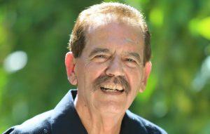Alfredo Mirandé smiles