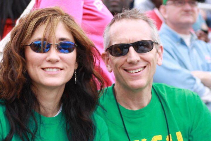 Laura and Chris Hamilton attend their son CJ's Cross Country meet at U-High.
