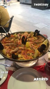 Paella with 20:25 and Thursday and Madrid written on the photo
