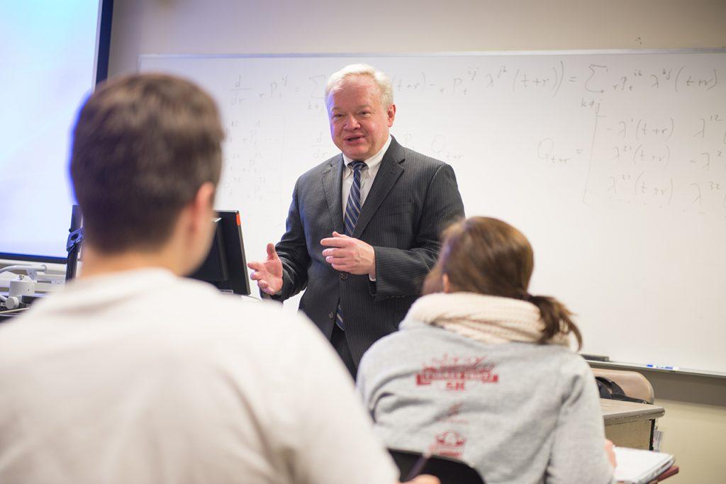 KrzysztofOstaszewski, Professor of Mathematicsand Actuarial Program director teaching class.