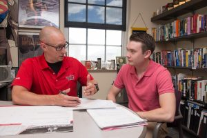 An Illinois State faculty member meets with a student—something you can take advantage of with your own college visit.
