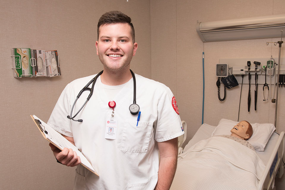 nursing student holds clipboard