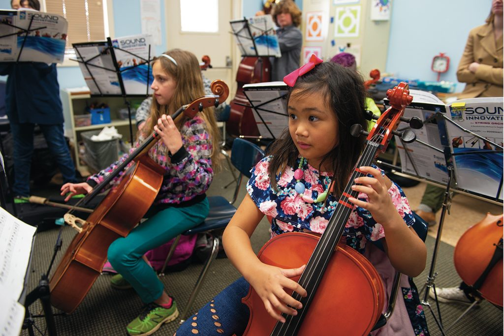 Children playing stringed instruments in ISU class at Western Avenue Community Center in Bloomington.