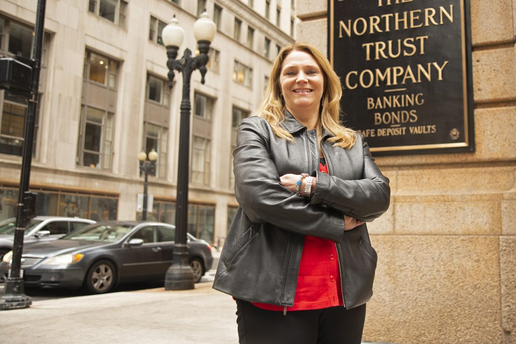 Barb O'Malley standing outside the Northern Trust Company Building