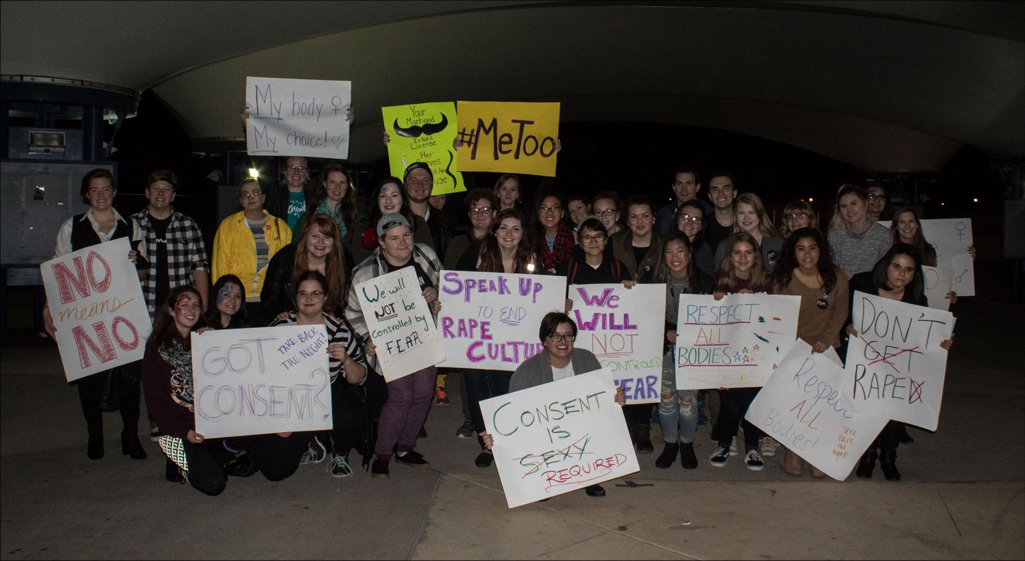 Students holding signs in favor of consent and the #MeToo movement