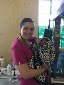 Abby Mustread, ISU Bone Scholar, holding a baby that she helped deliver in a rural hospital in Kenya.