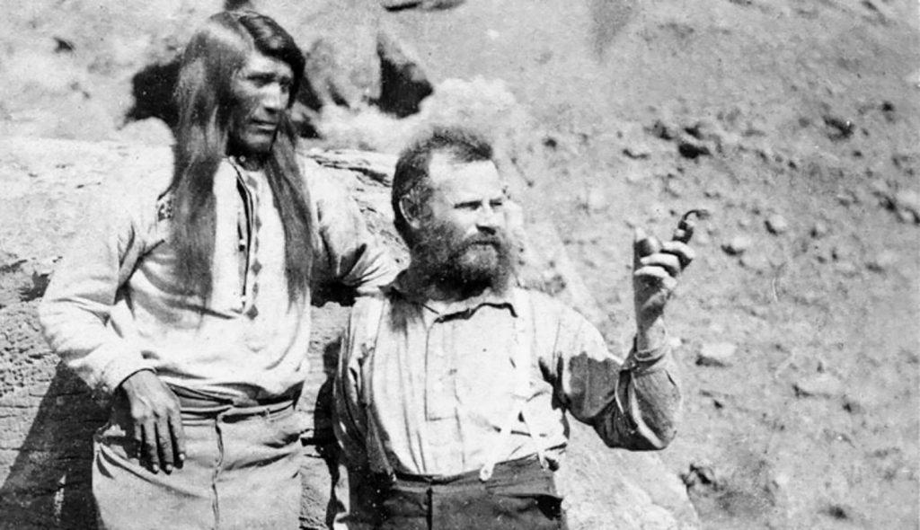 Two men talking amid a rocky terrain