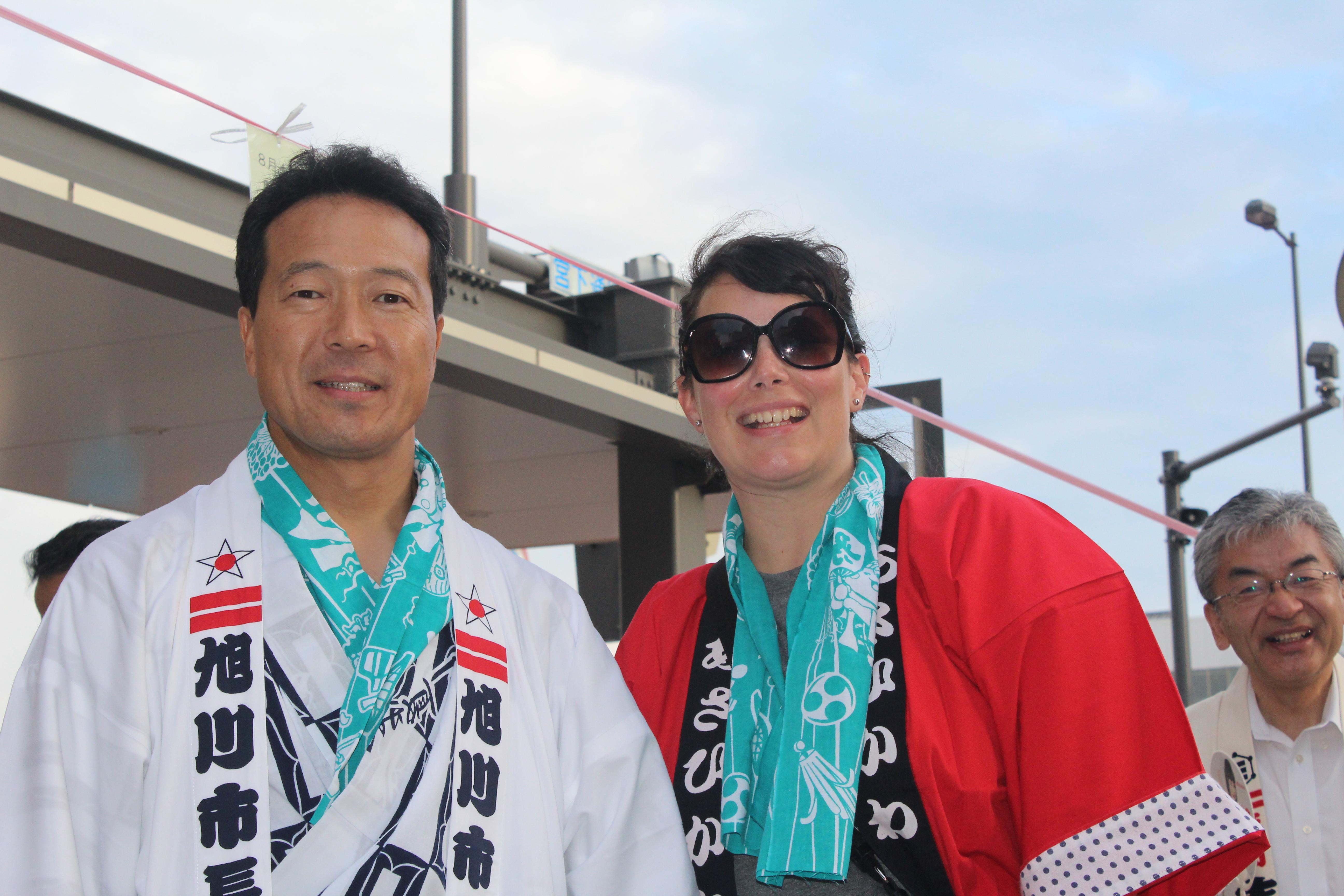 Harriett Steinbach poses with the mayor of Asahikawa, Japan