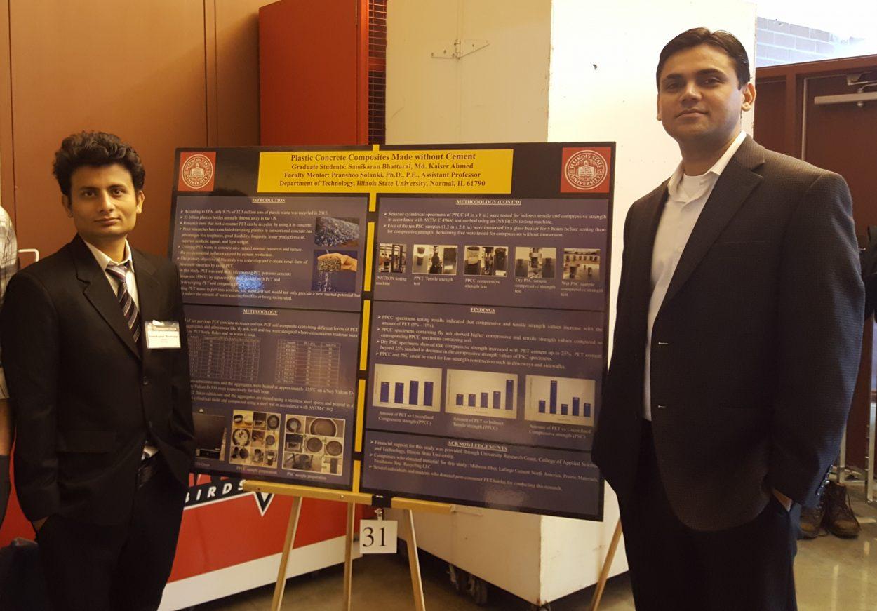 Samikaran Bhattarai with Associate Professor Pranshoo Solanki in front of poster display