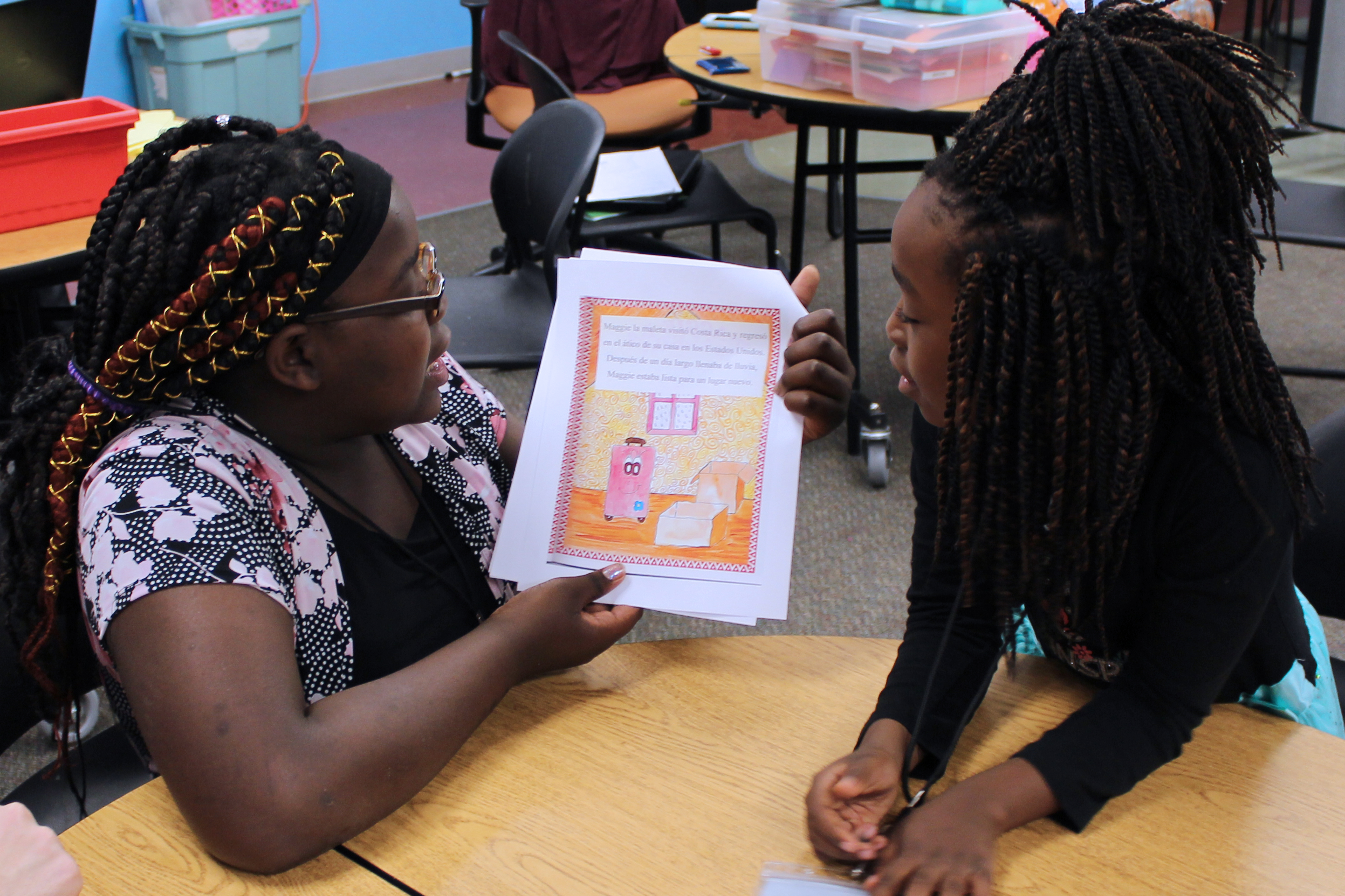 Unity youth read a book in Spanish