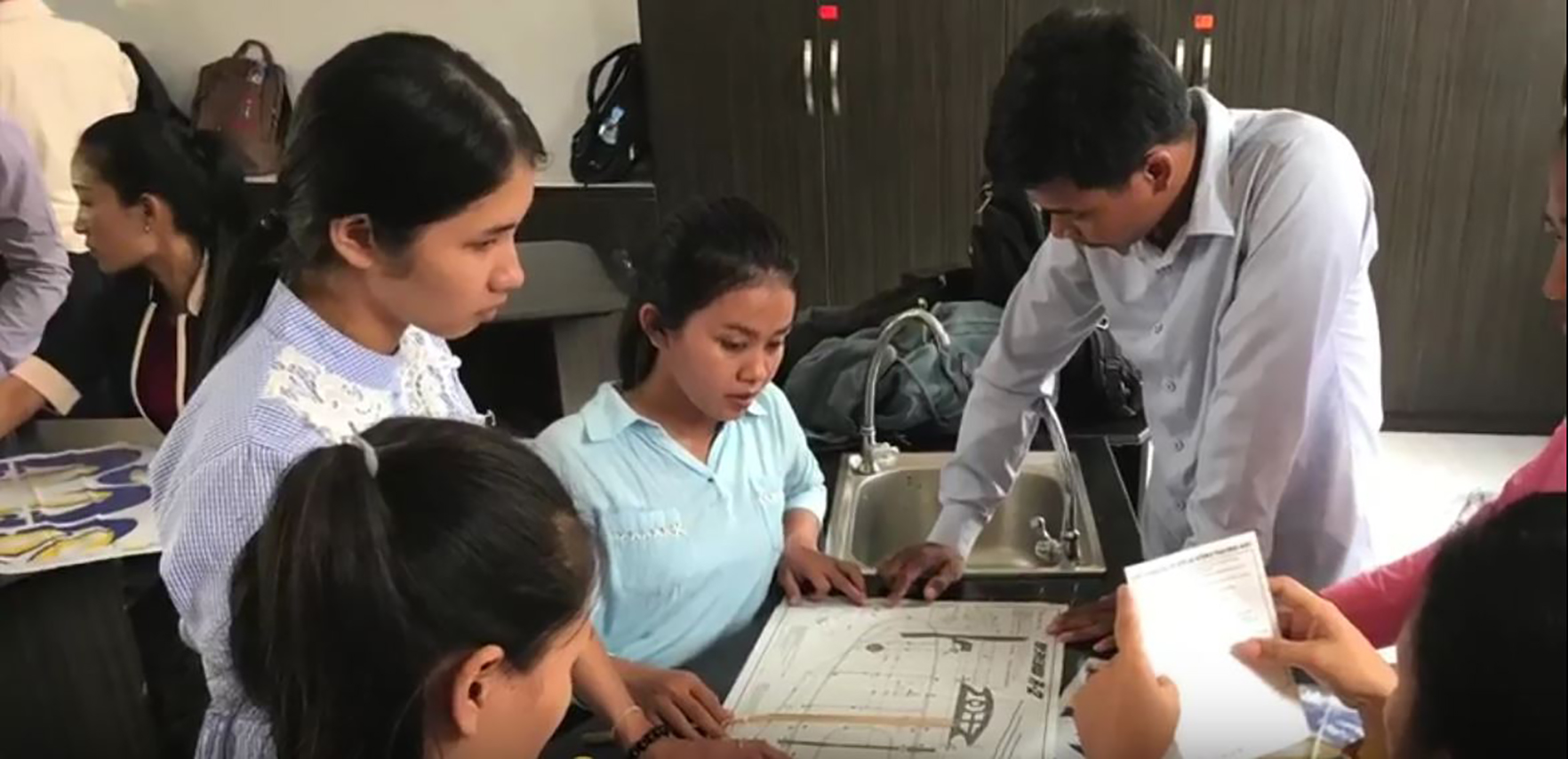 Students working on STEM projects in Cambodia
