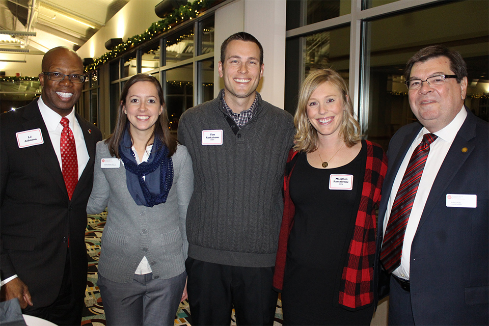 young alumni connect at an alumni event