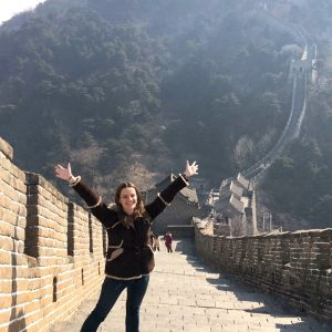 Beth Hollander teaches music in China, and has traveled to five continents and 14 countries. Here she is at the Great Wall of China.