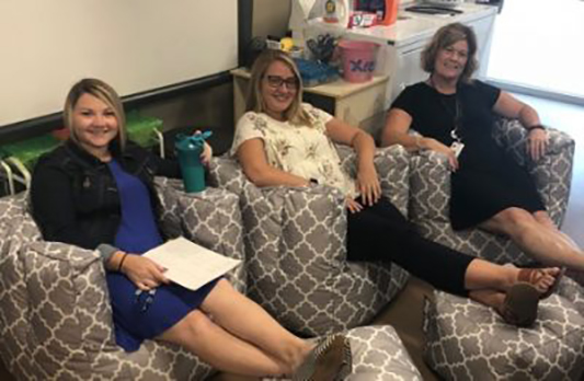 Haley Garrison, Ellie Scott, and Becca Massey show off their new comfortable chairs.