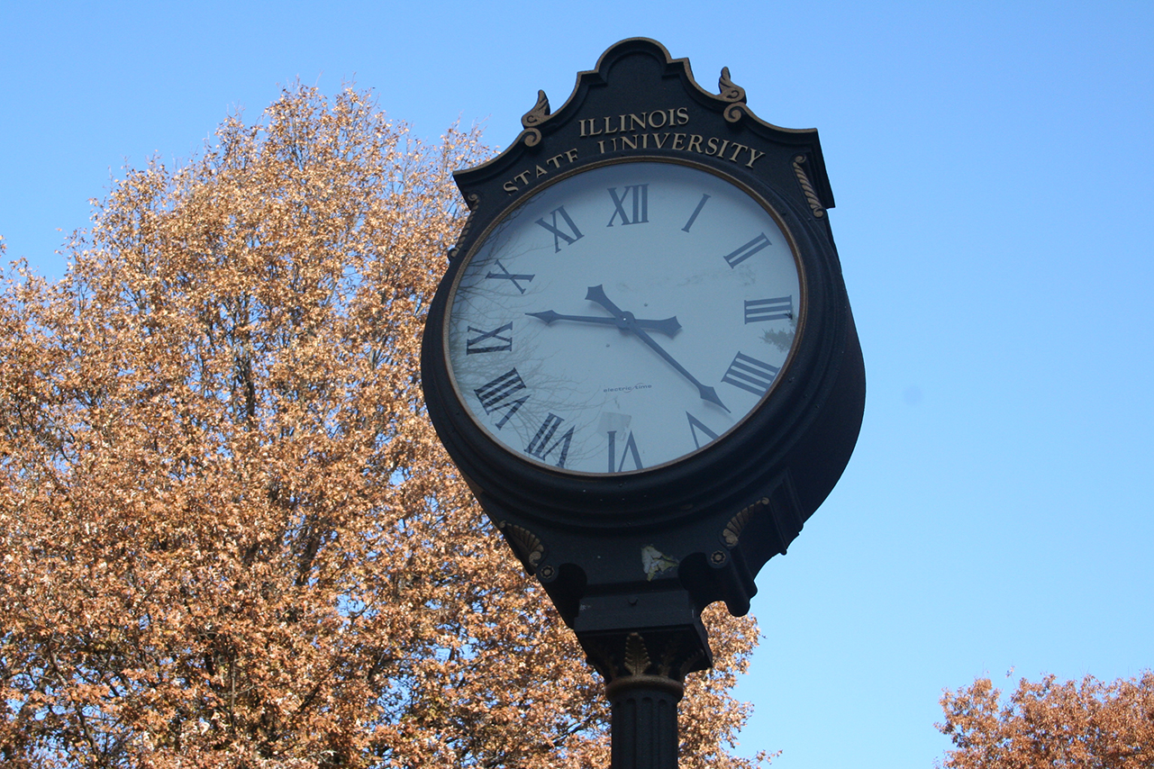 Illinois State University clock on the Quad in the fall
