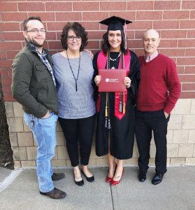 Kendra Cranford with her family and her diploma