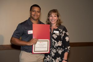 Tyler Bryant received the Student Access and Accommodation Services Educational Enhancement Scholarship from Sarah Metivier, coordinator of the text conversion lab at SAAS in October.
