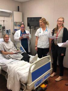 Students surround a patient