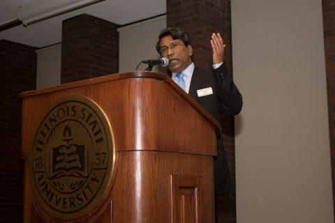 Ali Riaz giving a speech at podium