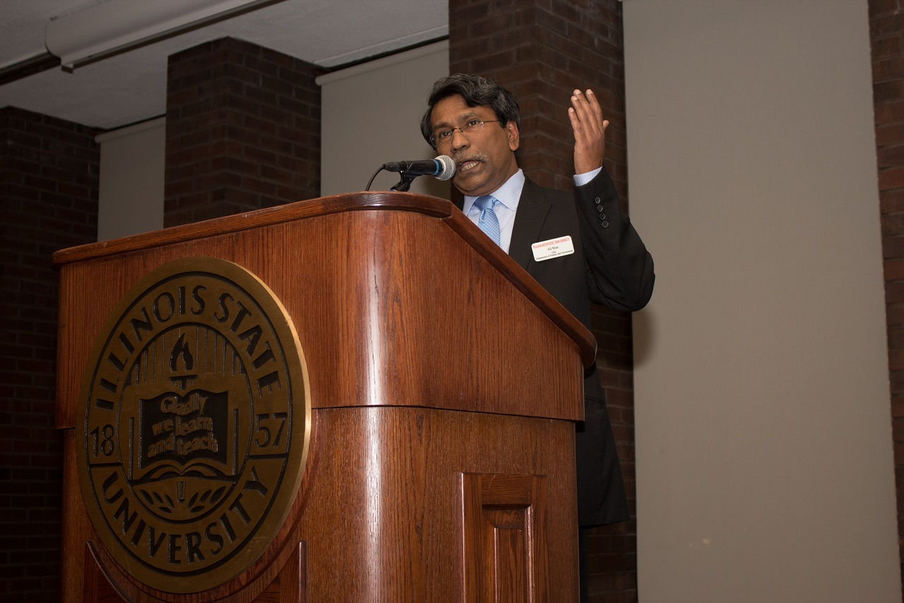 Ali Riaz giving a speech at podium