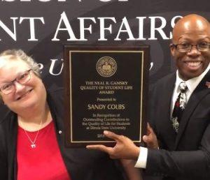 LJ Jhnson holding Sandy Colbs' Gamsky Award