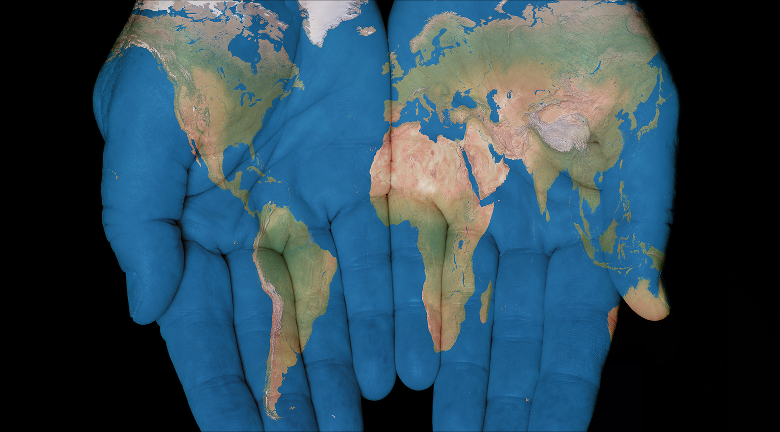 image of the map pf the world painted onto open hands