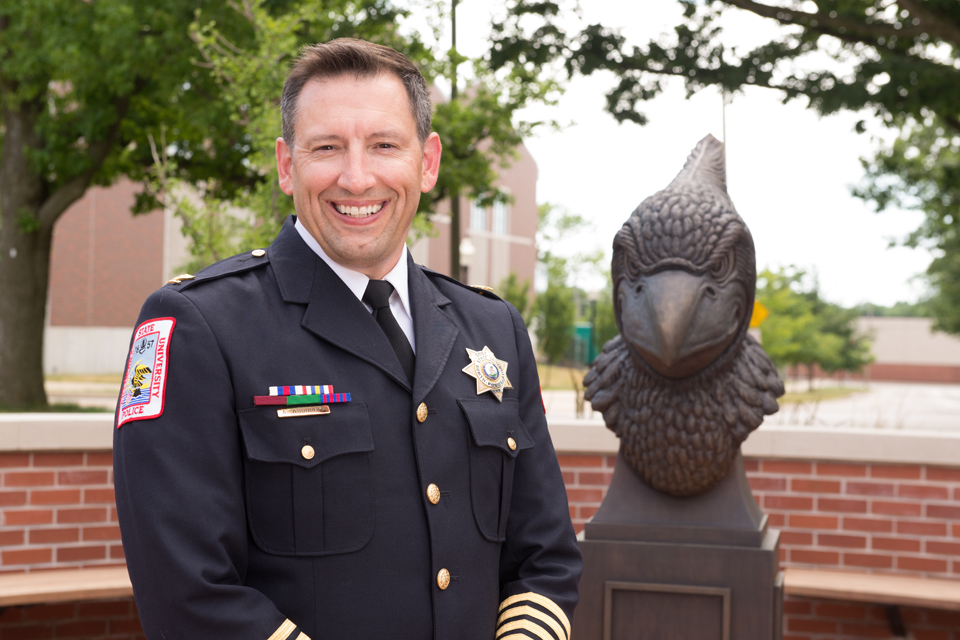 police officer next to Redbird bust