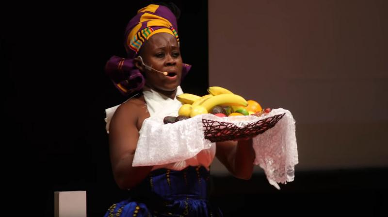 woman holding an offering of fruit