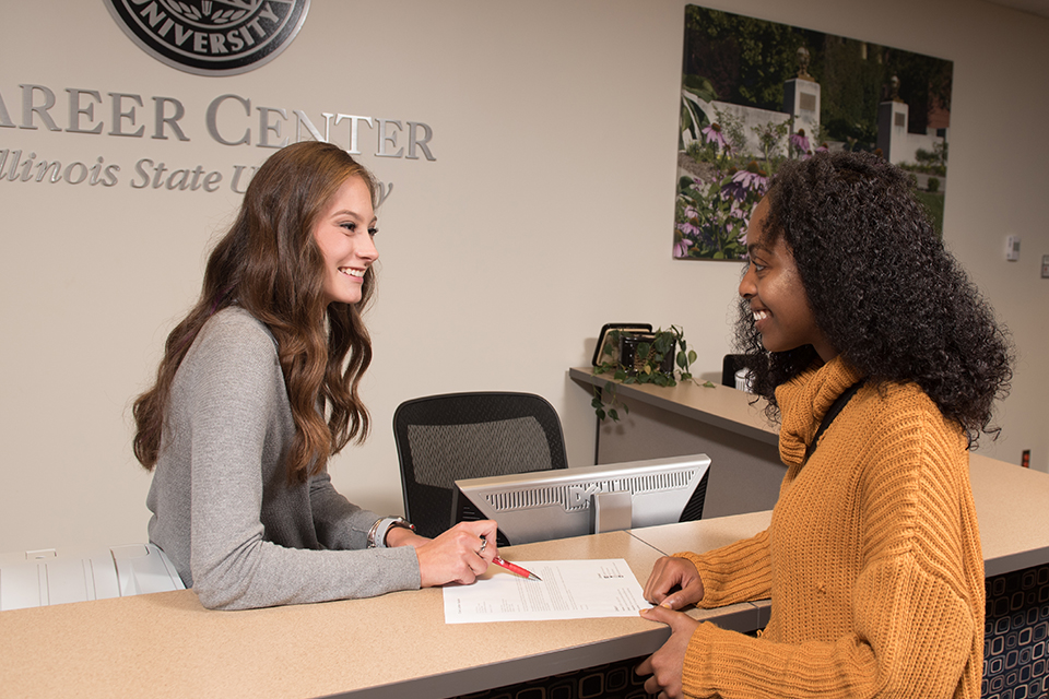 Student career ambassadors assist their peers with resume critiques during drop-in hours at the Career Center.