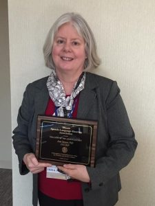 Associate Professor Jean Sawyer holding plaque