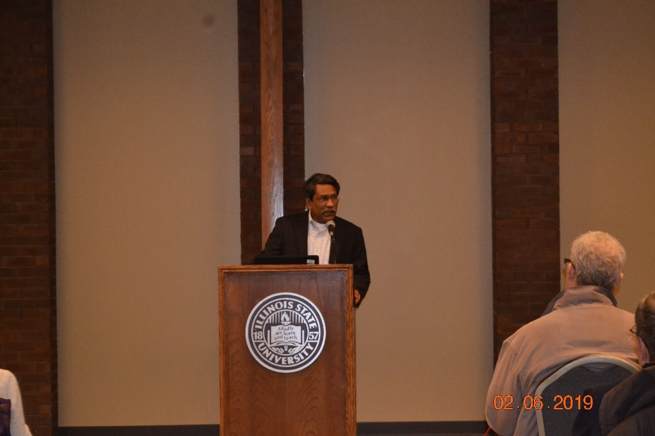 Ali Riaz at the podium giving a lecture