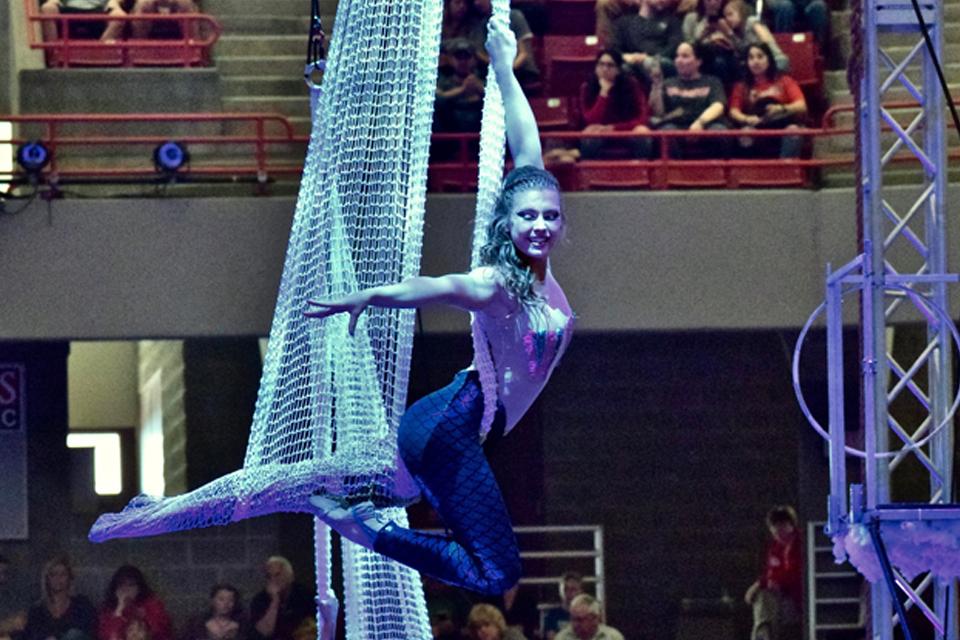 girl performing on aerial silks