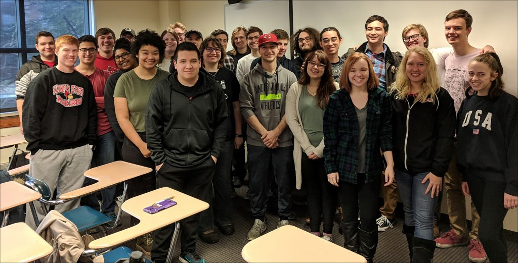 Students posing in a classroom