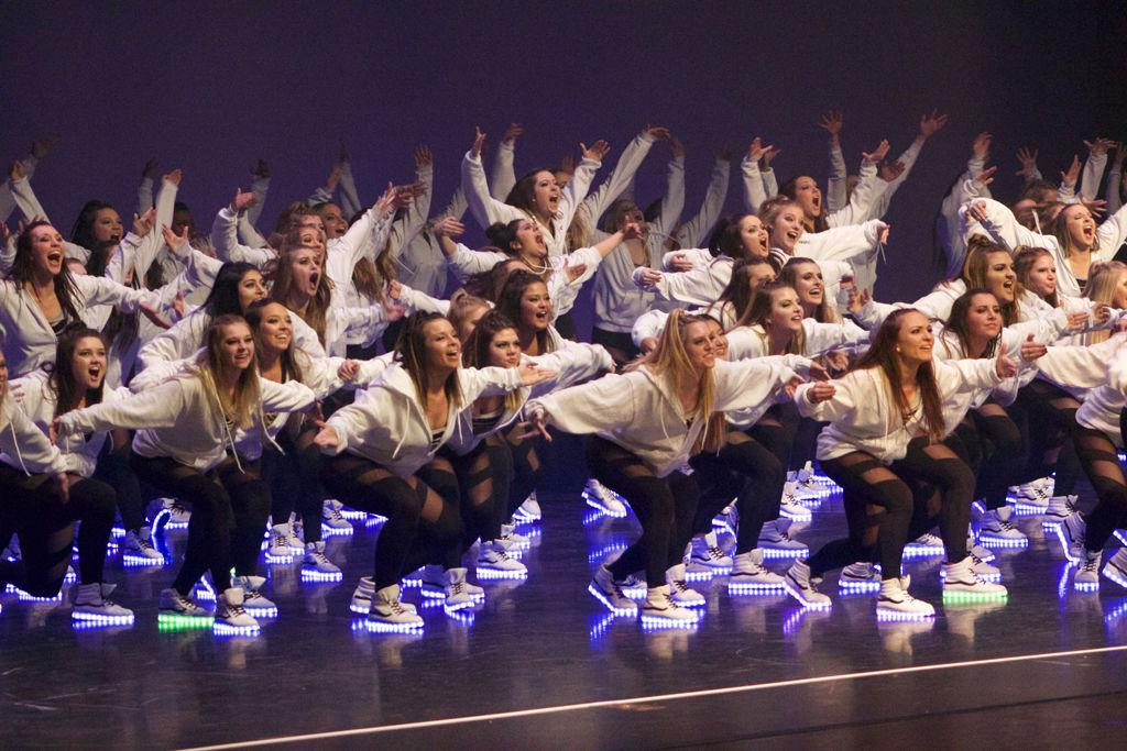 Sorority members dance on stage