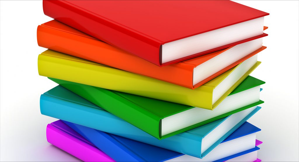 stack of books in rainbow colors