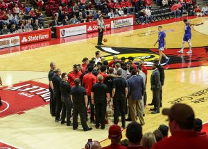 The student-managers form the glue that holds the men's basketball team together.