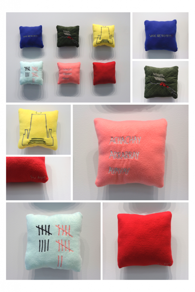 Pillows made by Camila Pasquel that represent her home country of Ecuador and the immigrant's experience