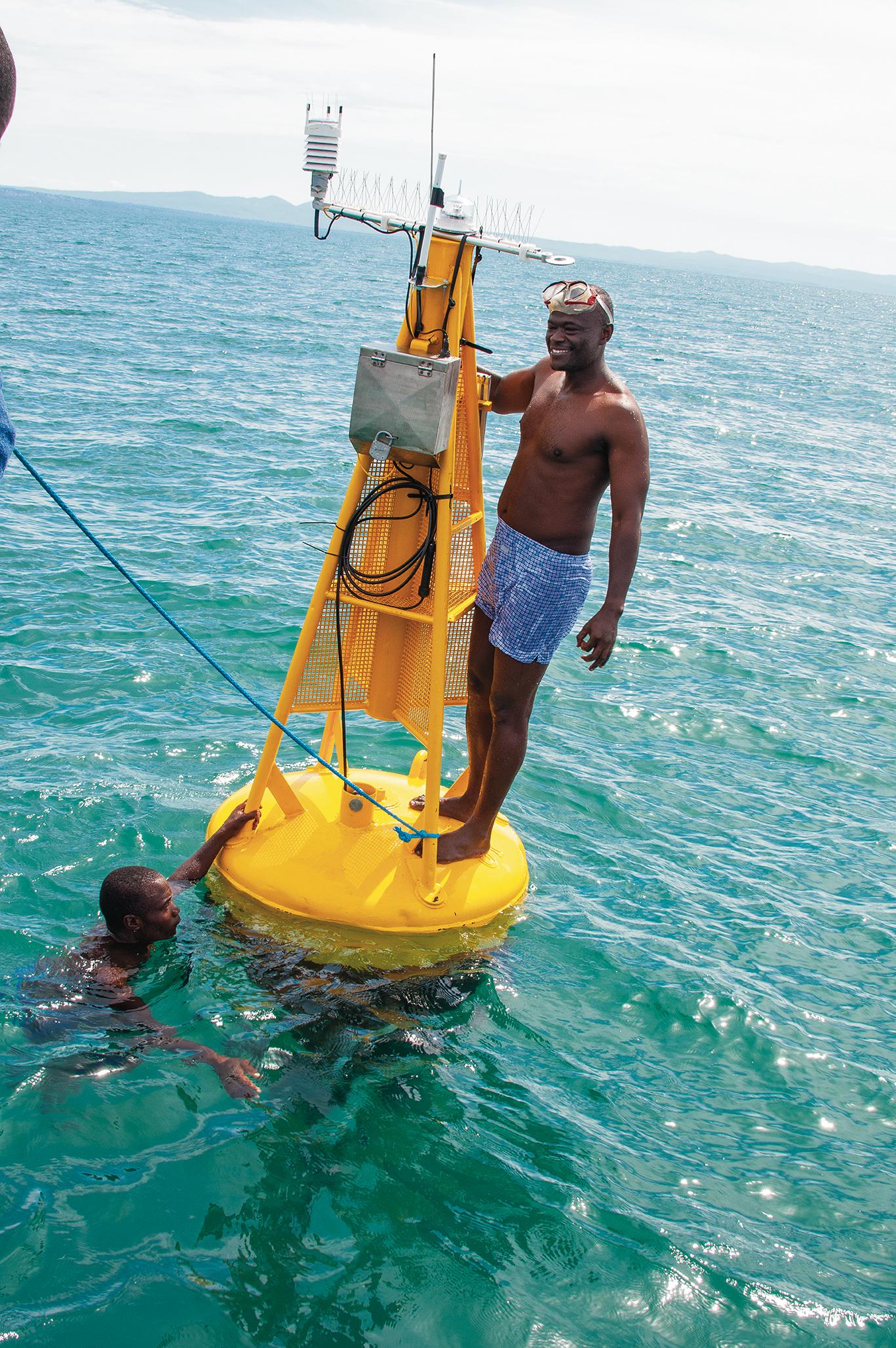 TAFIRI members check the buoy gathering temperature measurements in Lake Tanganyika.
