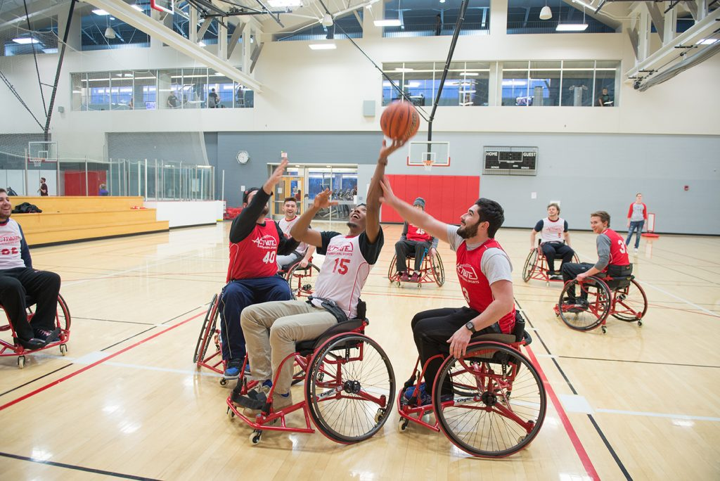ISU students play wheelchair basketball during the fifth annual Adaptapalooza.