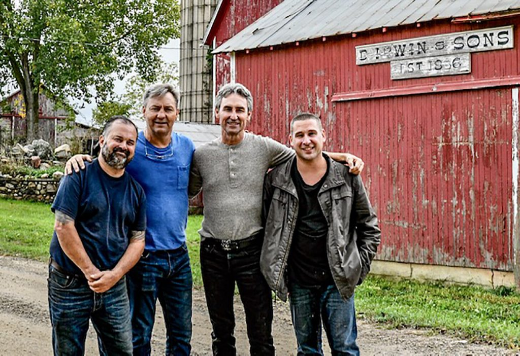 Jim Irwin (far right) with American Pickers hosts Frank Fritz (left), Robbie Wolfe, and Mike Wolfe at the Irwins' farm.