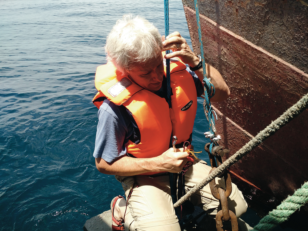 Illinois State Associate Professor of Biology William Perry gets a closer look at one of the anchors for the buoy deployment on Lake Tanganyika.