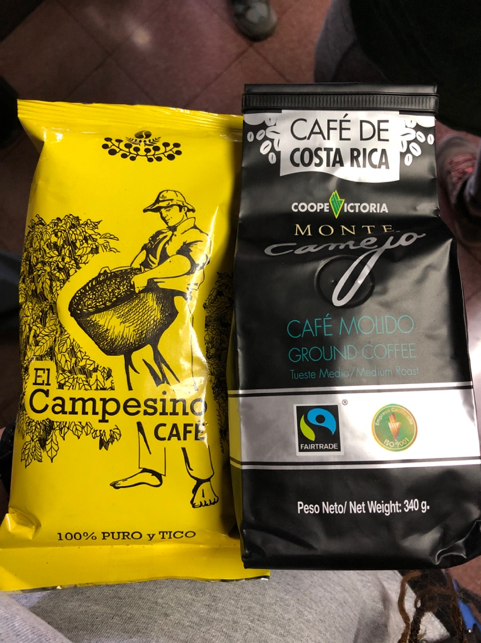 "A yellow bag of ""El Campesino Café"" and a bag of ""Café de Costa Rica fair trade coffee."
