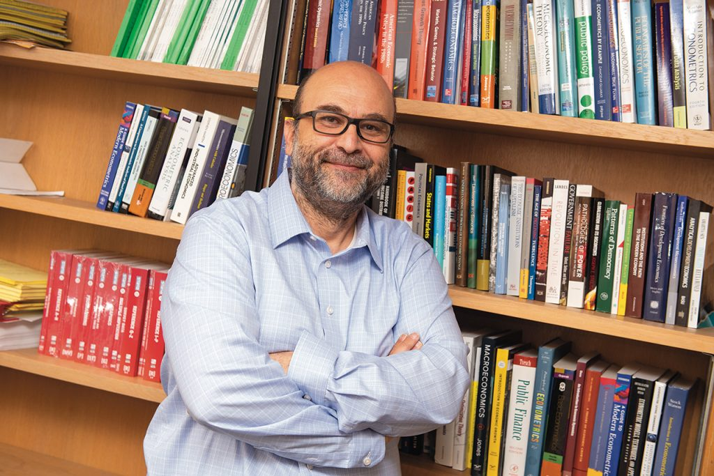Associate Professor of Economics Oguzhan Dincer