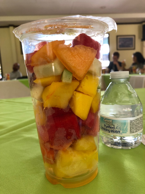 A fruit cup with watermelon, mango, pineapple, cantaloupe, melon, strawberries and papaya.