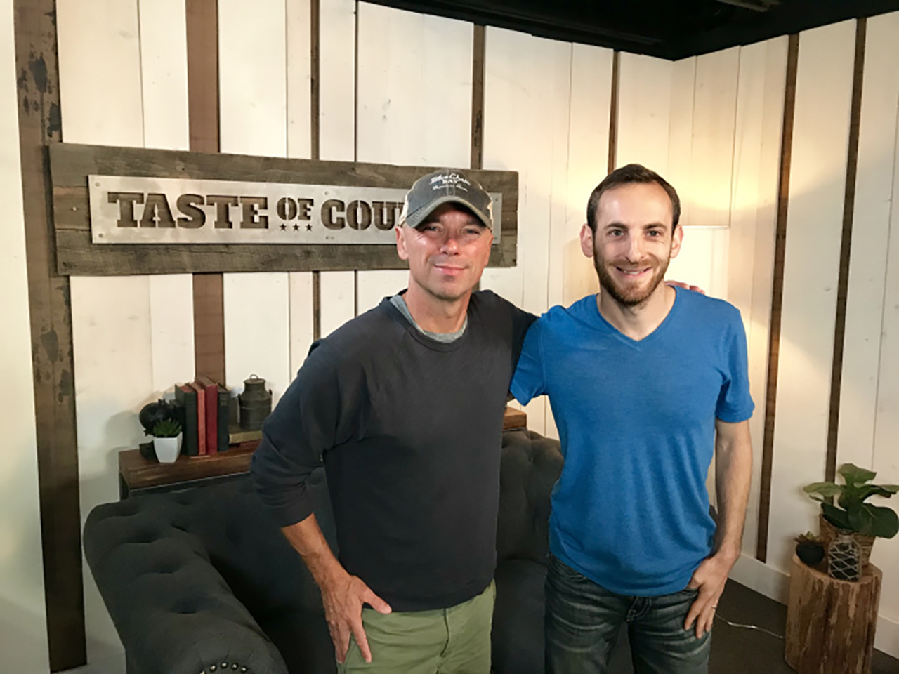 Sam Alex (left) has become a nationally renowned radio host by interviewing the likes of country music star Kenny Chesney.